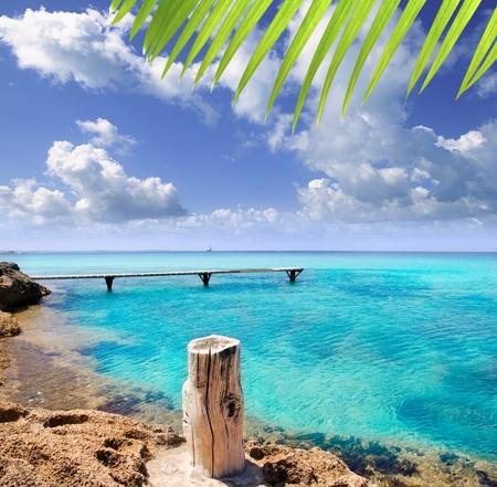 baleares: Illetes illetas beach with wooden pier and turquoise sea Formentera Balearic Mediterranean island Stock Photo