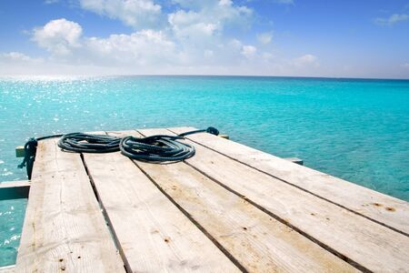 beaches of spain: Formentera beach wood pier over turquoise water from balearic Mediterranean sea paradise