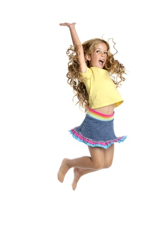 portrait young girl studio: little beautiful girl fly jumping up isolated on white studio background