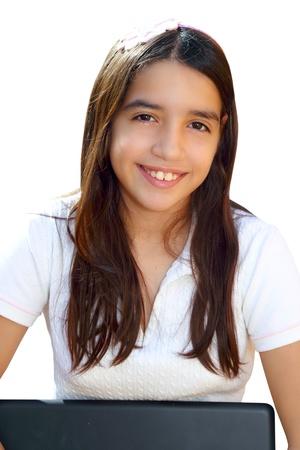 Latin teenager student smiling holding laptop isolated on white photo