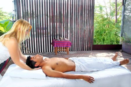 cranial sacral massage therapy in Jungle cabin tropical rainforest photo