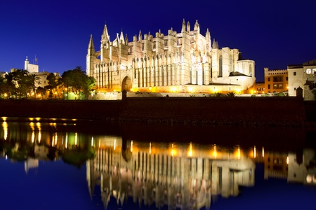 Cathedral of la Seu Majorca in Palma de Mallorca reflection over lake at Balearic islands photo