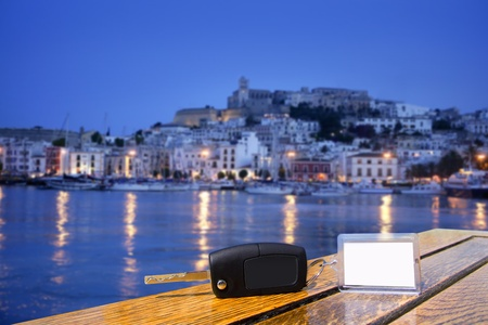 Car rental keys on wood table with blank paper in Ibiza town Mediterranean island Stock Photo - 9942586