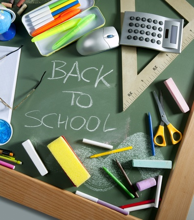 stuff: Back to school written in green blackboard education concept still life Stock Photo