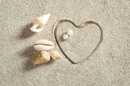 beach white sand with heart shape printed such a summer vacation concept still life photo