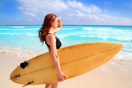 roo: surfer woman side view in a tropical sea looking waves from Caribbean sea Stock Photo