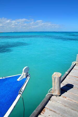 boat in wood pier Cancun tropical Caribbean beach photo