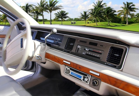 retro vintage car indoor with Caribbean golf course in window view photo