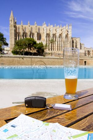 Car rental keys on wood table with city tourist map in Palma de Mallorca cathedral Stock Photo - 10048812