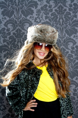 children fashion blond girl with fur winter coat sunglasses and hat Stock Photo - 10048832
