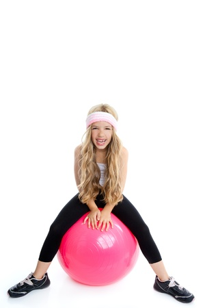 children gym yoga girl with pilate pink ball isolated on white photo