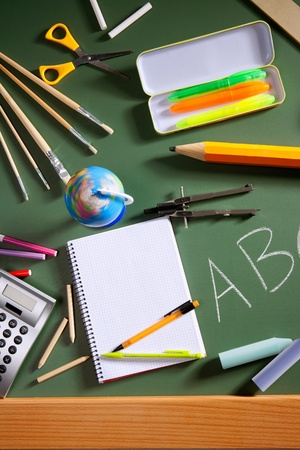 green back: back to school concept with ABC written in school in green color blackboard Stock Photo