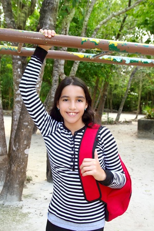 indian teenager: hispanic latin mexican teenager student girl with backpack in the park Stock Photo