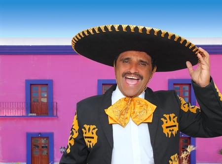 mariachi: Charro mariachi man portrait shouting in mexican pink house Stock Photo