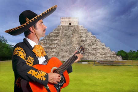 Charro Mariachi playing guitar in Chichen Itza pyramid Mexico photo