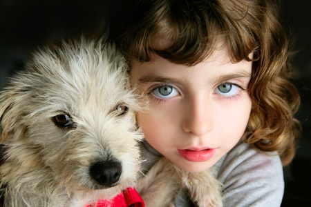 hairy closeup: blue eyes girl hug a hairy puppy little dog portrait
