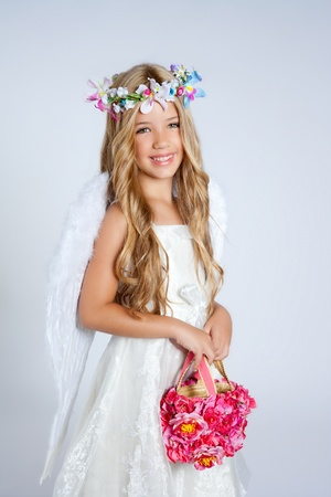 angelic: Angel children girl with white wings and flowers crown Stock Photo