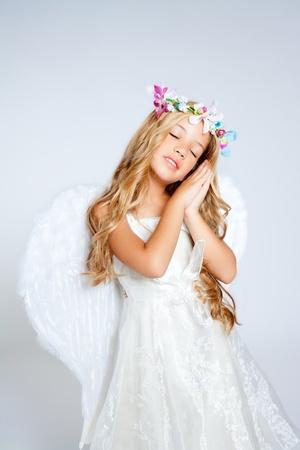 Angel children blond girl with sleeping hands gesture Stock Photo - 10214143