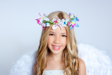 Angel children girl with white wings and flowers crown photo