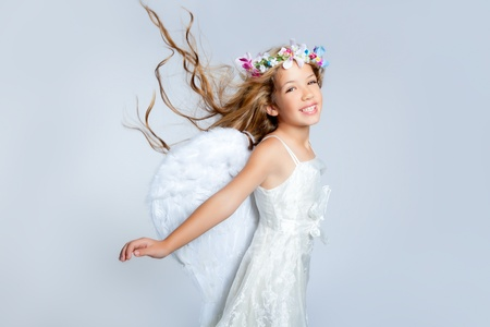 angel girl: Angel children girl with white wings and flowers crown Stock Photo