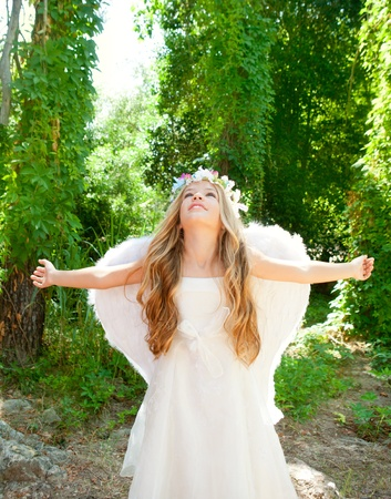 angel tree: Angel children girl open arms in forest with white wings and flowers crown