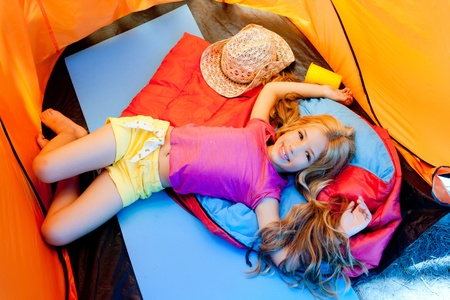 camping tent: Children girl lying on camping tent floor in vacation