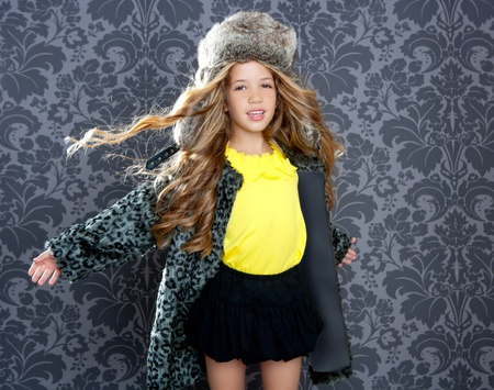 children fashion little girl with winter leopard coat and fur hat Stock Photo - 10214481