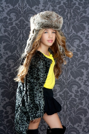 children fashion little girl with winter leopard coat and fur hat Stock Photo - 10214496