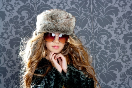 children fashion girl with fur winter coat photo