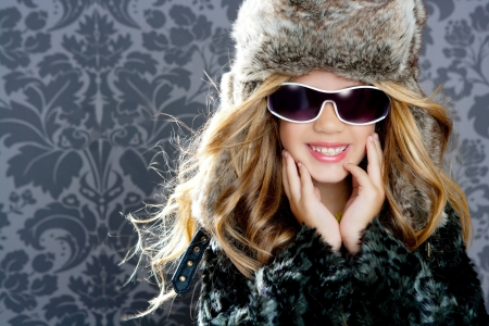 winter fashion: children fashion girl with fur winter coat Stock Photo