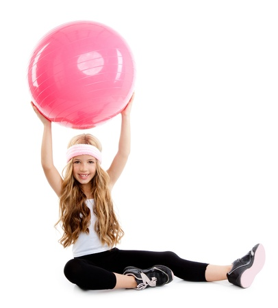 children at gym with pilates pink ball on white photo