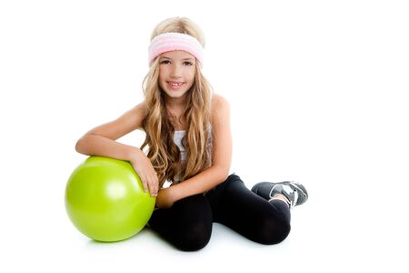 Children gym girl with green yoga ball relaxed photo