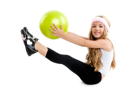 gym girl: Children gym girl with green yoga ball on pilates exercise