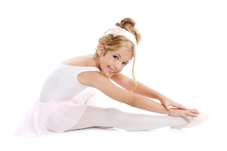 little girl dancing: Ballerina children dancer sitting on white Stock Photo