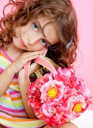 brunette girl holding fashion spring flowers bag photo
