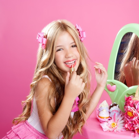 little girl: fashion little doll girl in pink vanity mirror with lipstick