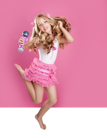 blond singer star girl like fashion doll with mic jumping high photo