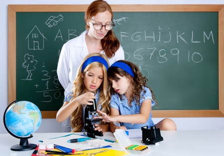 kids students with nerd teacher woman at science classroom