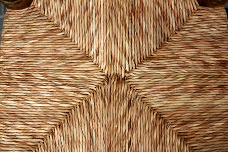 interlace: enea chair seat handcrafted with traditional dried reeds grass in Spain Stock Photo