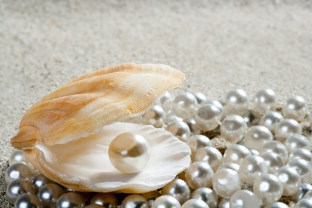 mother of pearl: Caribbean pearl inside clam shell over white sand beach Stock Photo