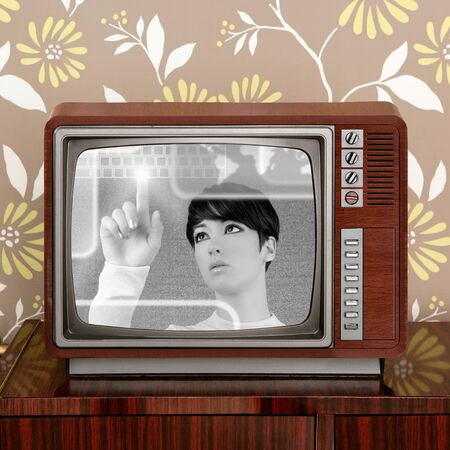 tv retro: futuristic and retro contrast in vintage tv screen appear a futuristic woman Stock Photo