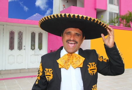 Charro mariachi man portrait shouting in mexican pink house photo
