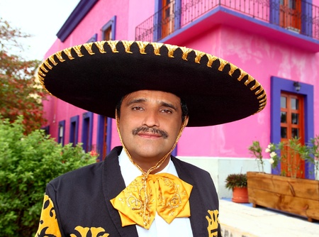 Charro mexican Mariachi man portrait in a pink Mexico house photo