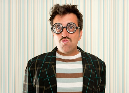myopic: nerd silly myopic man with glasses doing funny expression with retro mustache Stock Photo