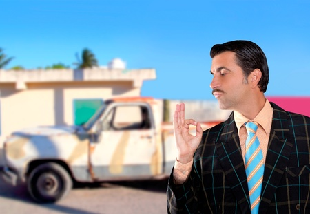 car used salesperson selling old car as brand new  typical topic salesman with hand ok gesture Stock Photo - 10437687