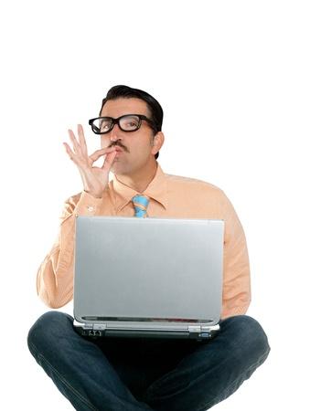 dork: nerd man sit with laptop computer doing ok positive gesture Stock Photo