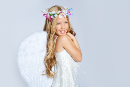angel hair: Angel children girl with white wings and flowers crown Stock Photo