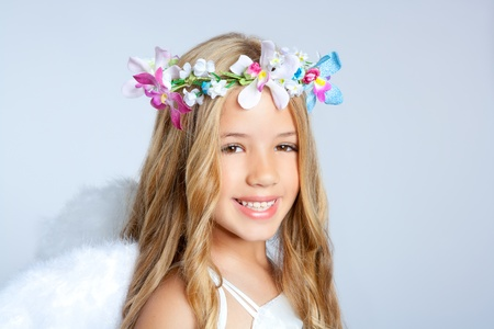 innocent girl: Angel children girl with white wings and flowers crown Stock Photo