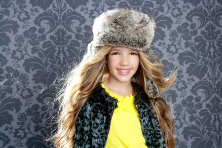 children fashion little girl with winter leopard coat and fur hat photo