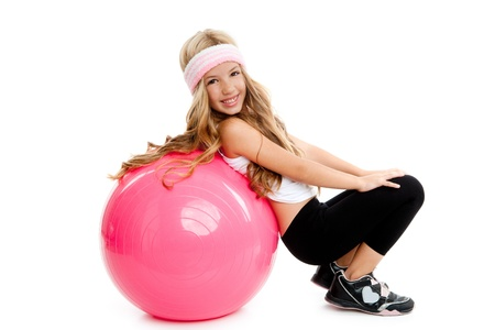 ball stretching: children at gym with pilates pink ball on white Stock Photo